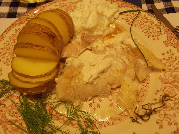 Italian cuisine from Giuseppe. Codfish in milk sauce with baked potatoes